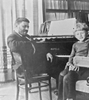 Einstein at the home of Leiden physics professor Paul Ehrenfest, 1920. On his lap is Paul Ehrenfest, Jr.