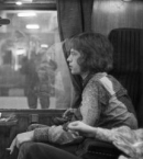 Paul McCartney and Mick Jagger on a train, 1967