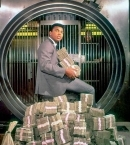 Muhammad Ali with his winnings in 1974.