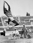 Rafer Johnson long jumping during the decathlon competition at the 1960 Olympics in Rome.